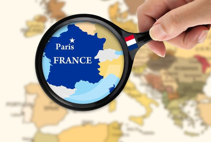 Magnifying glass over a map of France